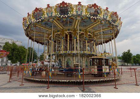 Beautiful carousel in the city square. Kiev Ukraine