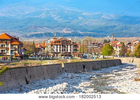 Bansko, Bulgaria April 14, 2017: Spring view with river Glazne, mountains landscape and houses
