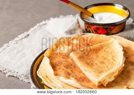 Stack Of Pancakes On A Plate With Sour Cream. Traditional For Th