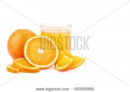 A glass of orange juice with orange and slices on a white background. Isolated.