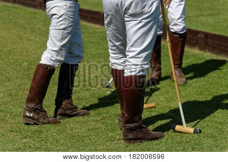 TSELEEVO, MOSCOW REGION, RUSSIA - JULY 26, 2014: Polo players in boots with mallets during the British Polo Day. Tseleevo Golf & Polo Club hosts the event for the second time