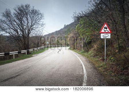 Slippery Road, Warning Roadsign In Rainy Day