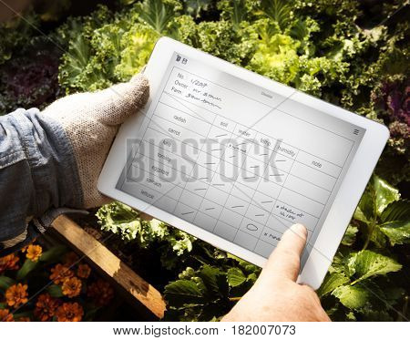 Man Holding Tablet Control Crop Plan List