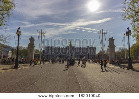 London England - 9th of April 2017: Tourists near the Buckingham Palace in the City of Westminster in London on a warm and sunny day.