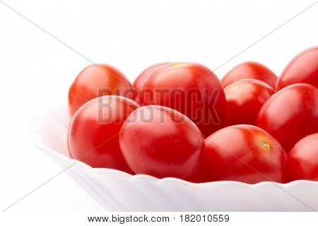 Dish with ripe  fresh tomatoes on a white background. Harvesting.