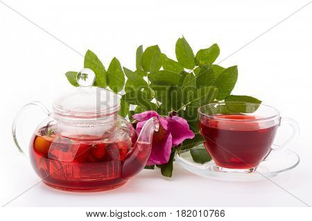 Healthy fruit tea from the rose hip in glass cup on on a white background.