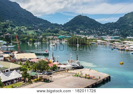 Victoria Mahe island Seychelles - December 17 2015: Attractive view of the city and boats in the harbor of Port Victoria Mahe island Seychelles Indian Ocean East Africa.