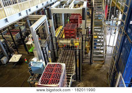 CESKE BUDEJOVICE, CZECH REPUBLIC - JUNE 30, 2016:  Budvar Budweiser brewery. Bottle sorting washing and beer bottling workshop.