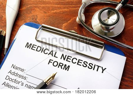 Medical Necessity form on a wooden table.