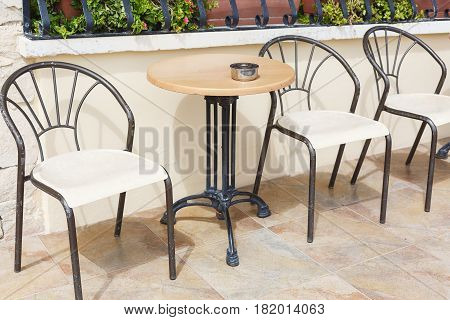 Modern chairs and tables on a patio in Malta