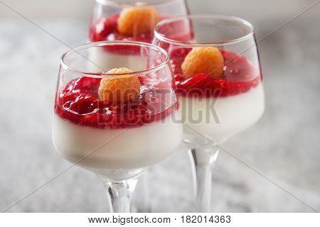 Italian Dessert. Vanilla Panna Cotta With Raspberry Jam. Stone B