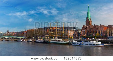 Embankment of the Weser River and Protestant Lutheran Saint Martin Church in the old town of Bremen, Germany. Panoramic view.