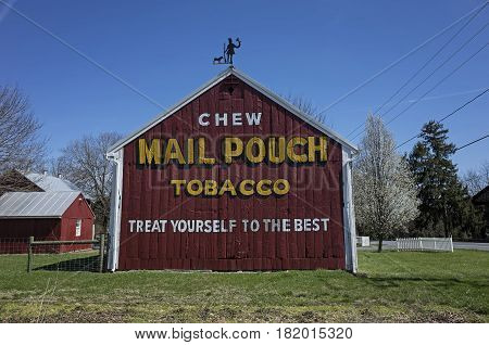 BRICKERVILLE, PA, USA-APRIL 9, 2017:  A Mail Pouch Tobacco barn.  It is a barn with one or more sides painted with an advertisement for the West Virginia Mail Pouch chewing tobacco company.