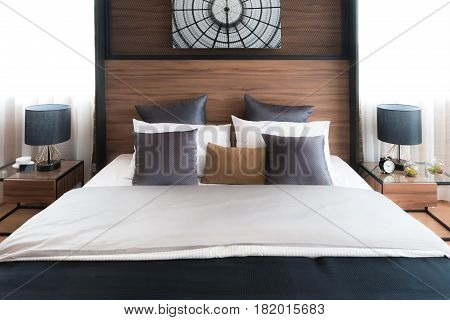 Interior of luxury bedroom in house or hotel with lamp. Interior bedroom concept.