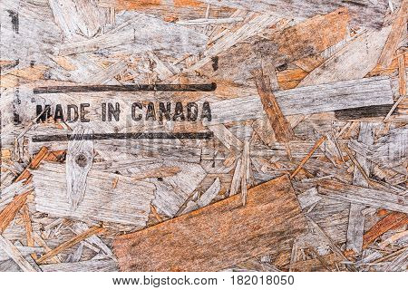 Made In Canada Text On Recycled Wood Board