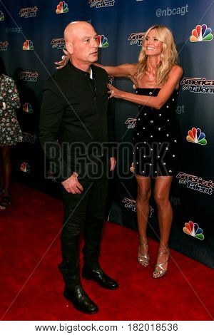 NEW YORK-AUG 19: Model Heidi Klum (R) and comedian Howie Mandel attend the 'America's Got Talent' Season 10 Results Show at Radio City Music Hall on August 19, 2015 in New York City.