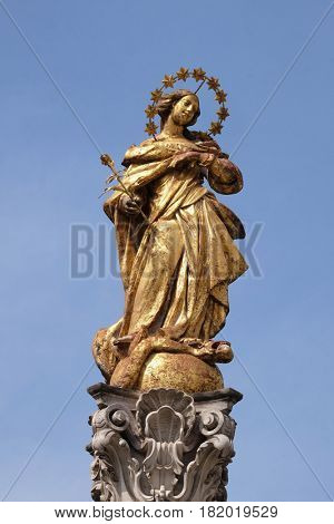 MARIBOR, SLOVENIA - APRIL 03: Virgin Mary statue, Plague column at Main Square of the city of Maribor in Slovenia, Europe. Historical religious sculpture, April 03, 2016.