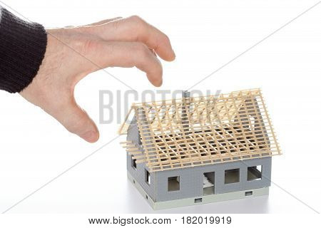 symbolic inheritance battle with hand and house