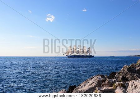 a big sailing boat is on the ocean