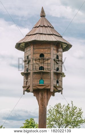 This photo shows a detail of old wooden dovecote in the village.