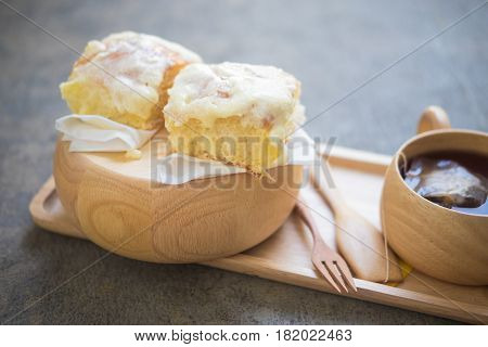 Butter bread sprinkled with sugar with cup of hot tea