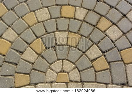 Texture of road surface with grey and yellow pave stones