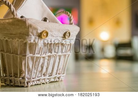 Close up paper tissues in decorative basket on restaurant table