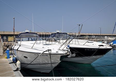 TENERIFE, SPAIN - JULY 1, 2011: Motorboats at the berth.