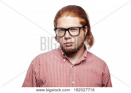 Sad unhappy bearded readhead businessman with red shirt and freckles looking at camera. studio shot isolated on white.