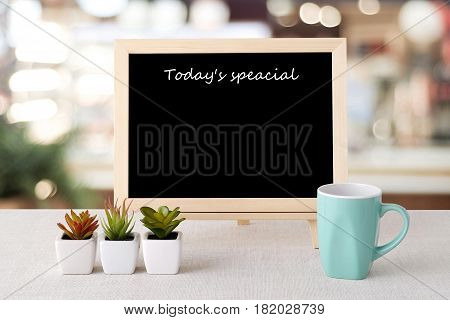 Today's special on blank chalk board over blur restaurant background food and drinks list background