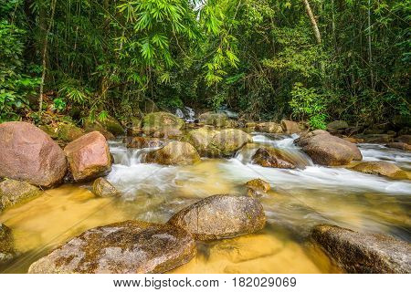 Waterway in national park flowing from waterfalls