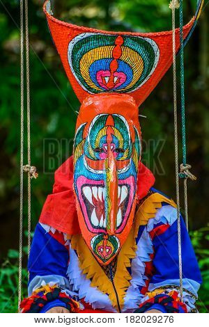 Kid dancers with ghost mask to show in Thai northeastern traditional Phi Ta Khon ghost Festival