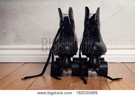 men's artistic roller skates on wood floor