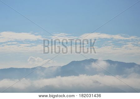 mist and cloudy floating on mountain in sunny day