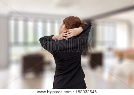 Businesswoman neck pain while standing at office - office syndrome concept