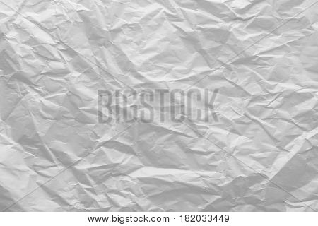 Wrinkled paper close-up. Gray Crumpled Paper Background