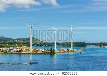 Victoria Mahe island Seychelles - December 17 2015: Wind turbines producing clean electricity in Victoria harbor Mahe Island Seychelles.