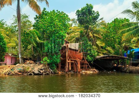Building Houseboat On The Canals Of Alleppey.