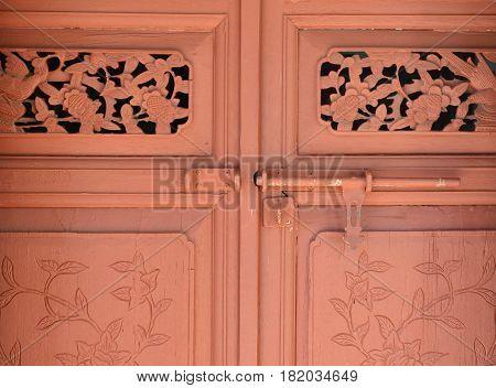 Brown carve wooden vintage door with padlock