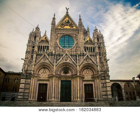 The ornate exterior of the cathedral Siena Italy