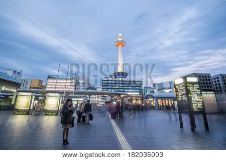Kyoto Japan - November 26 2015: Kyoto Tower in front of Kyoto Stationtower is the tallest in Kyoto height of 131 meters Kyoto Station is the city's transportation hub and also the site of a large bus terminal for city buses.