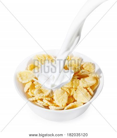 corn flakes with milk splash isolated on white background. Milk pouring into a white bowl of cornflakes. Healthy breakfast