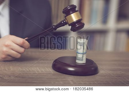 Detail of a corrupted judge saying a verdict on court. Selective focus