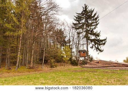 Hunting hide in the forest. Hunting stash. The wooden tower