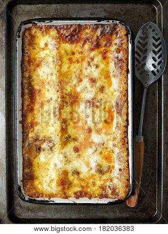 close up of rustic italian lasagna with bolognese ragu sauce