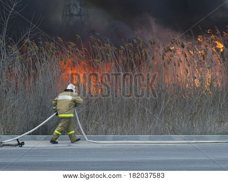 The fireman is in a hurry to put out the fire