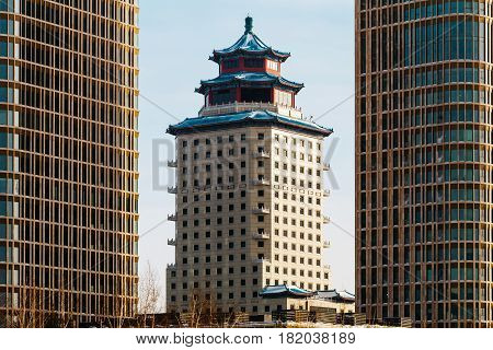 Chinese-style building Beijing Tower between two Talan Towers on a sunny day in Astana, Kazakhstan.