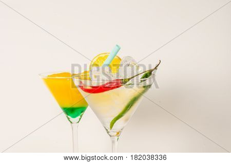 Set Of Two Drinks In Martini Glasses, Martini Drink And Yellow With Green, Lemon