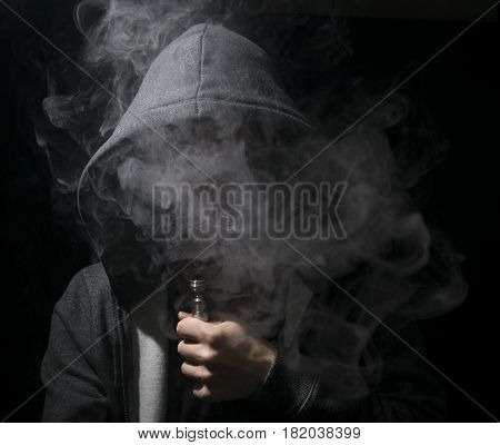 Young Person Vaping An E Cig With Lots Of Clouds.