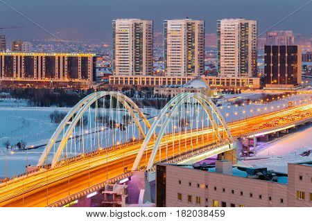 View from above on the M1 Bridge across the Ishim River on a winter evening in Astana, Kazakhstan.